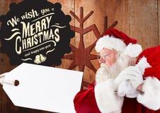 Wesoło bożych narodzeń powitania z Santa Claus mieniem grabiją Fotografia Stock