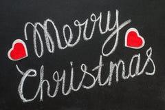 Wesoło bożych narodzeń tekst pisać na chalkboard Zdjęcia Royalty Free