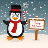 Wesoło bożych narodzeń znak z Szczęśliwym pingwinem Zdjęcia Stock