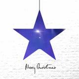 Wesoło kartka bożonarodzeniowa z połysk gwiazdą na papierowym tle Obrazy Stock