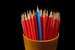 Wesoło ołówek wśród smutnego Obrazy Stock