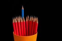 Wesoło ołówek wśród smutnego Fotografia Stock