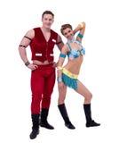 Wesoło tancerzy pozować ubieram jako Santa i dziewczyna Fotografia Stock