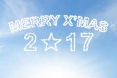 Wesoło xmas 2017 i gwiazdowa chmura na niebieskim niebie Fotografia Royalty Free