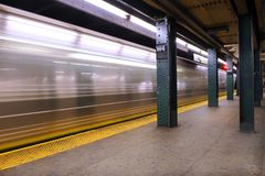 West 4 Subway Station with Subway. West 4 Subway Station in New York City showing Subway just leaving the station Royalty Free Stock Photos