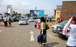 West African buyers hurry up to the shopping mall. Stock Photo