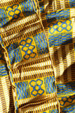 West African Fabric. Close up of a dress handmade from Kente Cloth in Ghana Stock Image