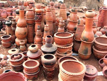 West African pottery stacked for sale. Stacks of West African pottery for sale Royalty Free Stock Image