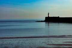 West arm of Newhaven Harbour Lighthouse Sussex. On a sunny day Stock Photos