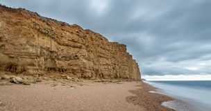 West bay beach on the Dorset Jurassic coast. On a stormy day stock images