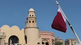 West Bay buildings with Qatar flag. Details of building with minaret in West Bay with Qatar flag in from Porto Arabia, The Pearl-Qatar`s main harbor in Doha stock video