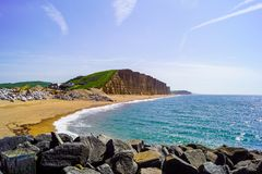 West Bay cliff view Standing on Rocks stock photography