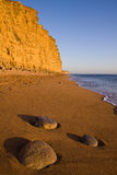 West Bay,Dorset,England. The cliffs at West Bay,Dorset,England illuminated by low sun Royalty Free Stock Photos