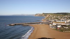 West Bay Dorset England uk beach waves and town stock video