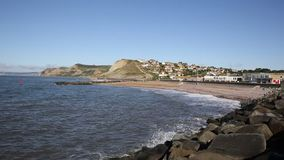 West Bay Dorset England uk beach and waves view to the west direction of Golden Cap stock video footage