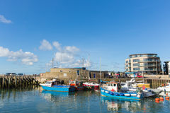 West bay harbour Dorset on a calm summer day with boats blue sky and sea Stock Photography