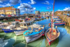 West Bay harbour Dorset England UK boats on calm summer day Stock Photography