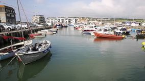 West Bay harbour Dorset England UK with fine calm weather in late summer pan stock video