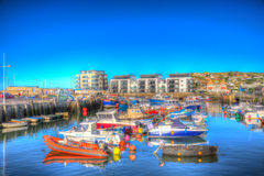 West Bay harbour Dorset UK boats on calm blue sky summer day Royalty Free Stock Image