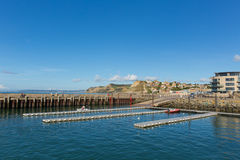 West bay harbour Dorset with view to Golden Cap on the Jurassic coast Royalty Free Stock Images