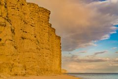 West Bay, Jurassic Coast, Dorset, UK. Clouds over the cliffs at West Bay, near Bridport, Jurassic Coast, Dorset, UK Stock Photos
