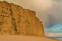 West Bay, Jurassic Coast, Dorset, UK. Clouds over the cliffs at West Bay, near Bridport, Jurassic Coast, Dorset, UK Stock Photography