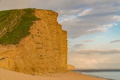 West Bay, Jurassic Coast, Dorset, UK. Clouds over the cliffs at West Bay, near Bridport, Jurassic Coast, Dorset, UK Royalty Free Stock Image