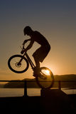 Silhouette BMX stunt Stock Photos