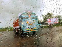 Rainy day- - cloudy weather. WEST BENGAL , INDIA , ASIA - SEP , 20 : Shooting in rain produces dramatic atmosphere and soft romantic scenes. Whether you are Royalty Free Stock Images