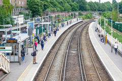 West Brompton overground station platforms, with commuters waiti Royalty Free Stock Photography