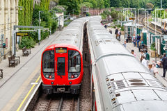 West Brompton underground station platforms, with commuters boar Royalty Free Stock Photo