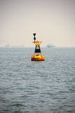 West cardinal buoy at Singapore anchorage. A west cardinal marking buoy indicating a danger to navigation to the East of the buoy Royalty Free Stock Image