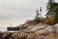 West Coast BC Canada granite rock cliff lighthouse Stock Photography