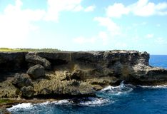 West coast cliff face, BridgeTown Barbados. View of the West coast cliff face in BridgeTown Barbados, with blue sky, clouds and crystal clear water stock photo