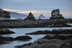 West Coast sunset. Low tide at Twelve Mile Beach near Greymouth, Westland, South Island, New Zealand Royalty Free Stock Photography