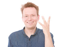 West coast. Young smiling man flashing you the west coast sign - isolated on white Royalty Free Stock Photography