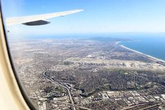 West coastline from the air. Aerial shot of pacific coastline and Los Angeles airport from a commercial airliner arriving at Los Angeles stock images