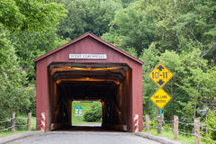 West Cornwall Covered Bridge. WEST CORNVALL, CONNECTICUT - JULY 15, 2015: The 1864 West Cornwall Covered Bridge. also known as Hart Bridge, is a wooden lattice stock photo