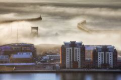 The west and east piers in Swansea. A heavy fog engulfs the west and east piers and the entrance to the docks at Swansea city UK on a Winter morning royalty free stock images
