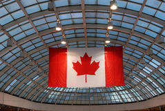 West edmonton mall. Canadian flag and the above glass ceiling in the west edmonton mall, the largest indoor shopping mall in north america, edmonton, alberta Royalty Free Stock Photo