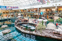 West Edmonton Mall in Alberta, Canada. Shoppers visit the West Edmonton Mall. At 5,300,000 sq ft, it is the largest shopping mall in North America and 10th Stock Images