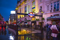 West End London Night. LONDON, UNITED KINGDOM - OCTOBER 8, 2014:  View of London Piccadilly Circus West End district seen at night with people and Underground Royalty Free Stock Photo