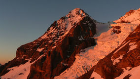 Eiger in the evening light. The west face of the Eiger near Grindelwald as seen in beautiful reddish evening light from the Guggi Hut stock photo