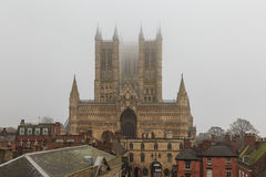 West face of Lincoln Cathedral, on a foggy day. Stock Images