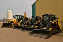 Row of New Holland skid steers Stock Photos