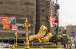 West flank of Golden Lions roundabout, Sihanoukville Cambodia. Sihanoukville, Cambodia - March 15, 2019: Golden Lions Roundabout. West flank of giant statues of royalty free stock photography