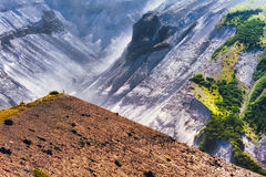 West flank of Mt. St. Helens. A man can be seen as a speck on the point of a hill overlooking the west flank of Mt. St. Helens stock photography