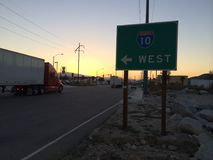 10 West Freeway Sign. Trucker highway desert sunrise Royalty Free Stock Photos
