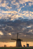Three windmills on a cloudy evening in Netherlands Stock Photography