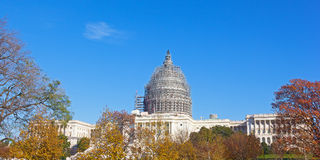 The west front of the United States Capitol with dome restoration scaffolding in autumn. Stock Image